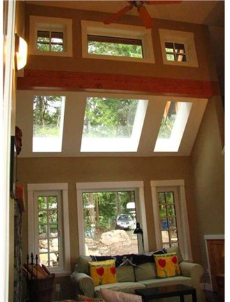 Skylights and clerestory windows in a two-story-tall living room