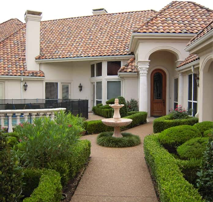 Walkways in this garden center and focus on the fountain in this Mediterranean home.