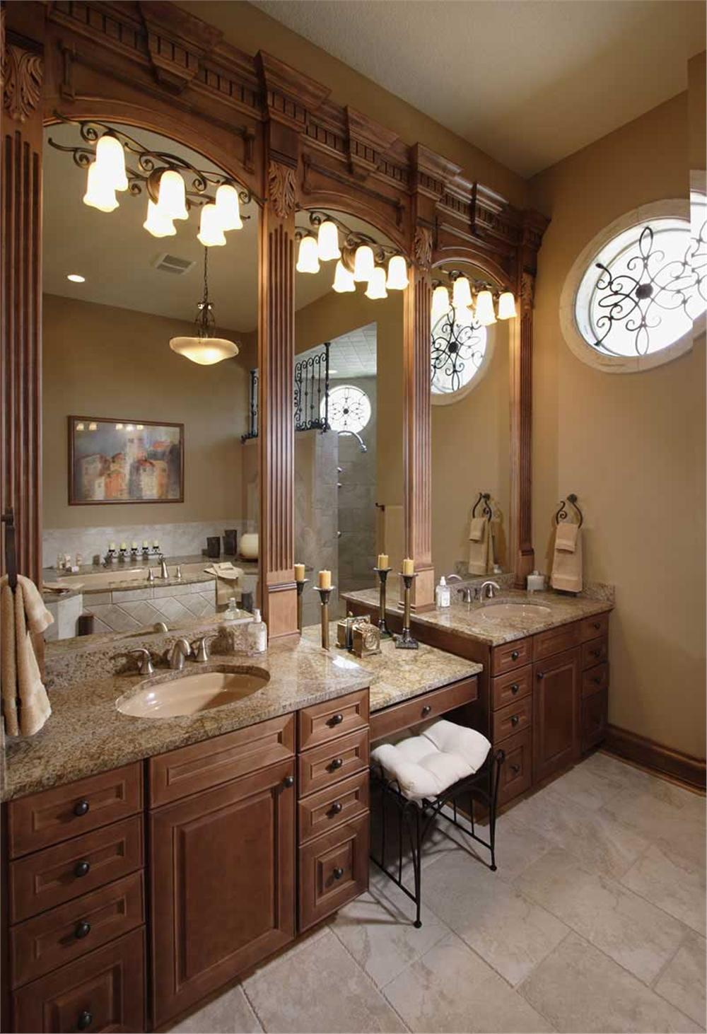 Two vanities separated by a seated makeup space in master bathroom of House Plan #101-1353
