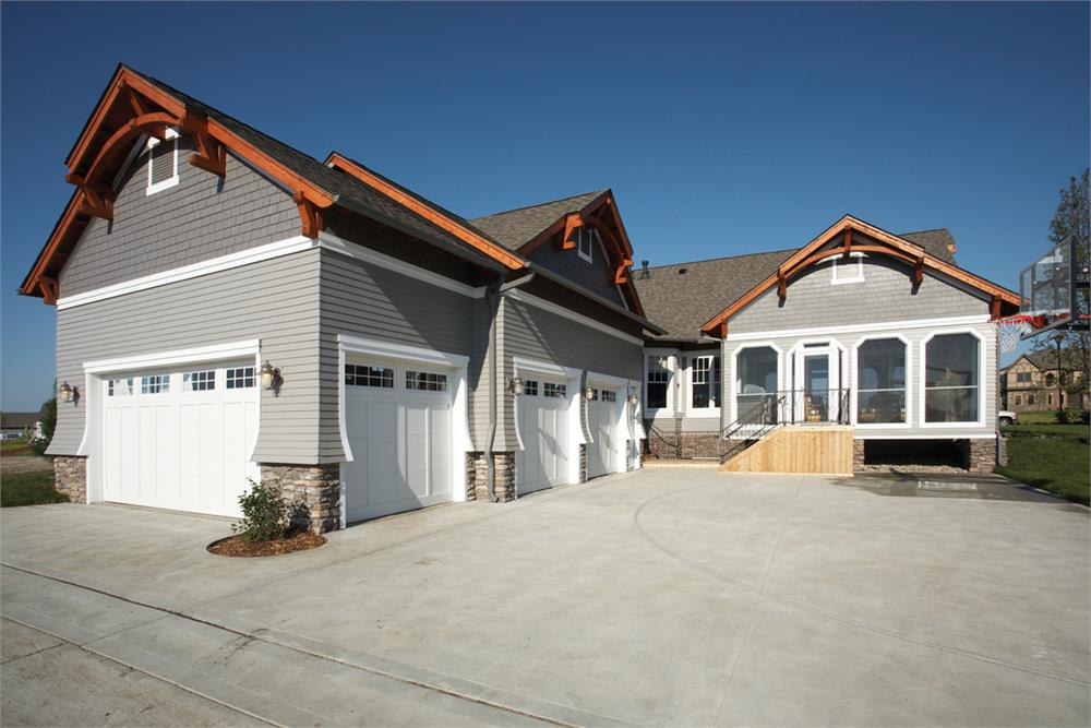Three-car garage at the back of a home with access from two walls on the end bay