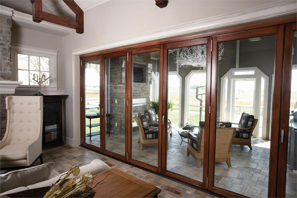 Wall of sliding glass doors that open onto covered patio