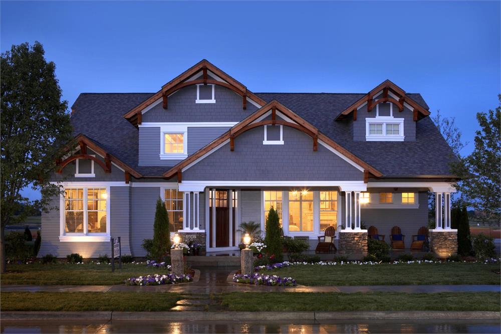 Craftsman style home with slate-blue siding and natural wood accents