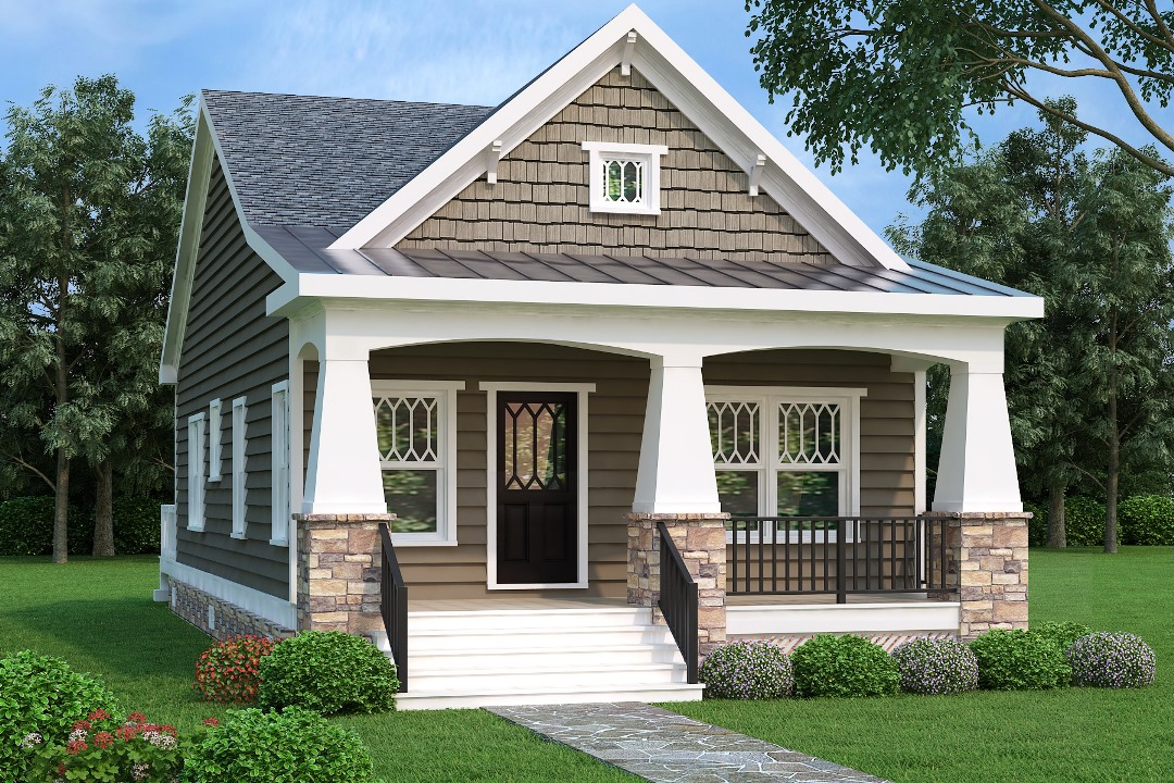Craftsman style home with wood shingle and clapboard siding and deep front porch