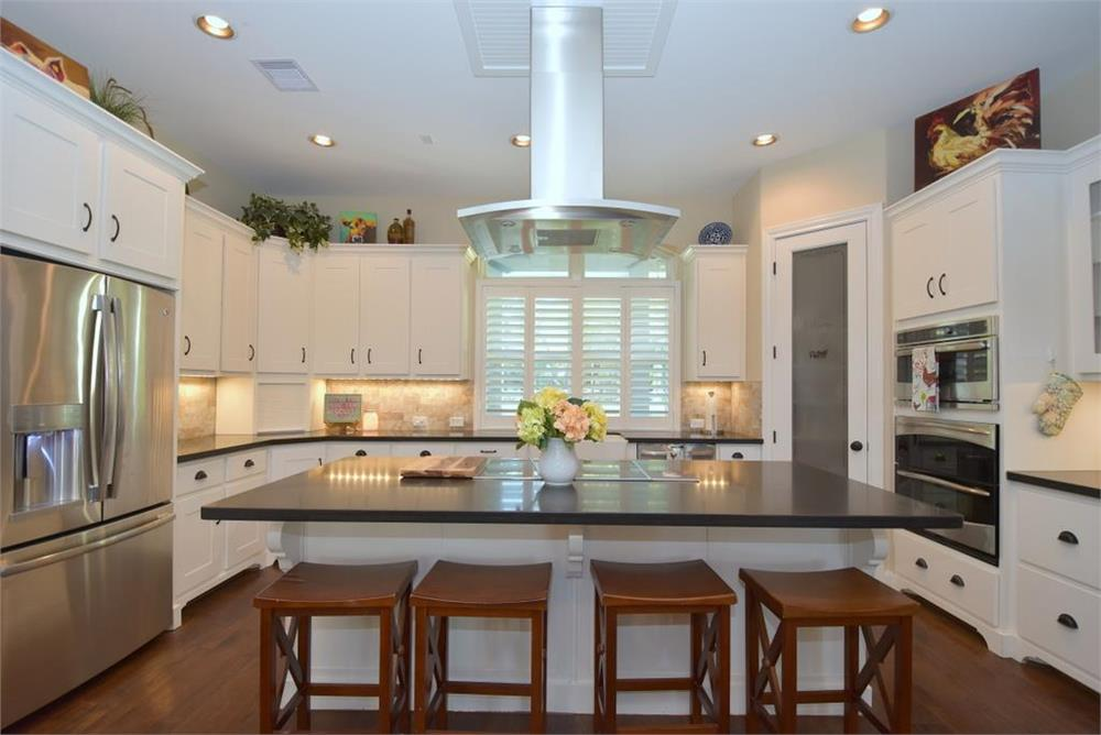 This white kitchen in House Plan #106-1274 feels homey
