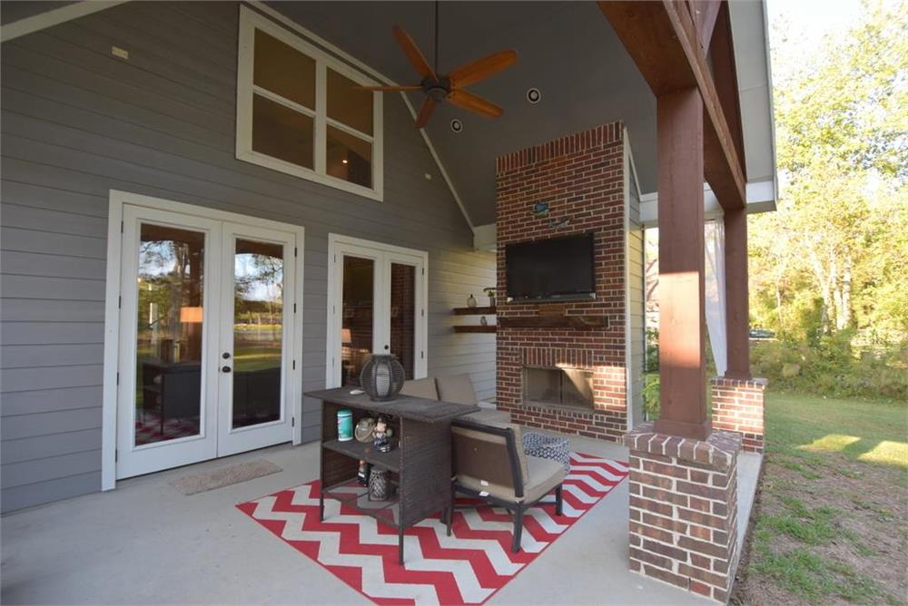 Relaxing covered patio in a 3-bedroom, 3.5-bath Country style Ranch home