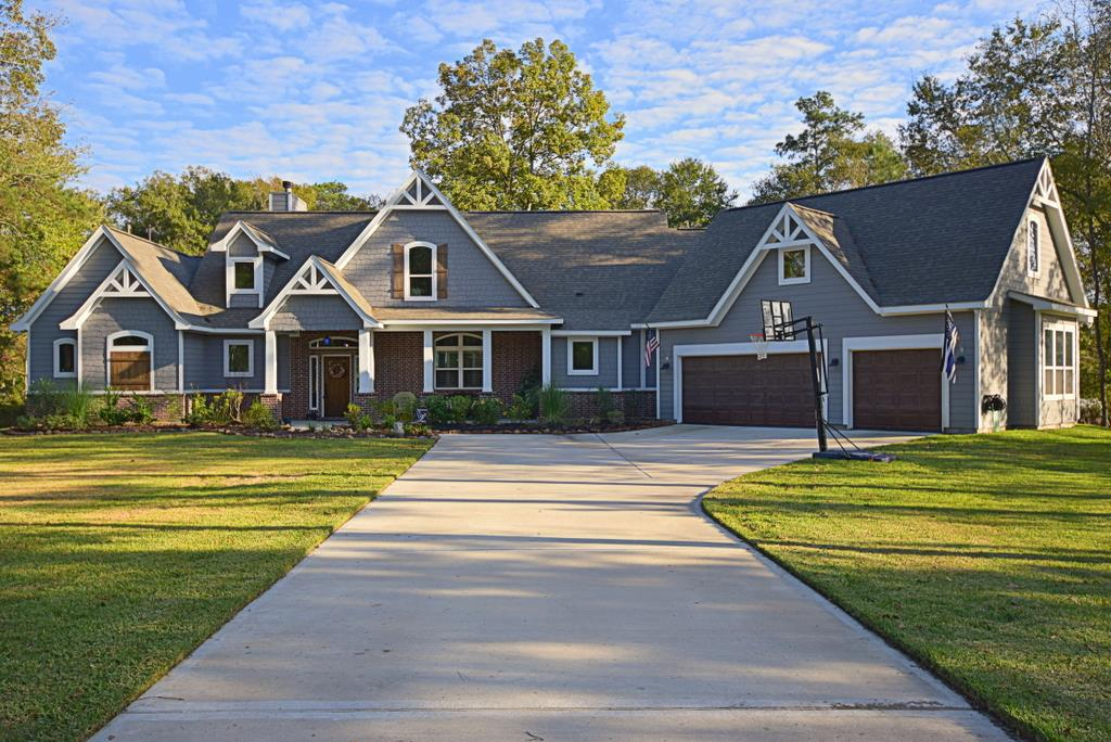 Beautiful rustic transitional Craftsman style home with wood and brick siding