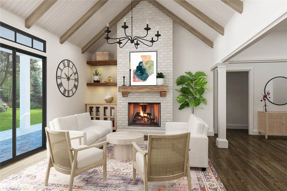 Family room with fireplace and vaulted ceiling with exposed timber rafters