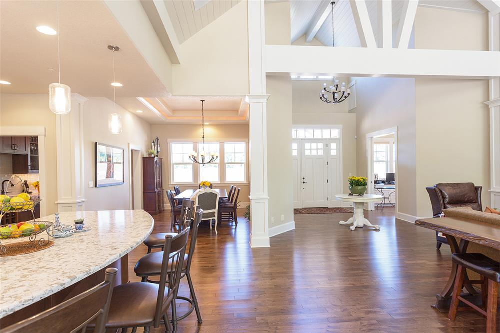 Open floor plan with white decor in 3-bedroom, 2.5 bath Craftsman style home