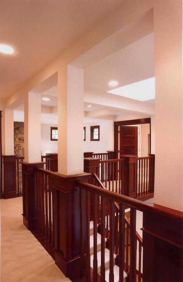 Stairs at second-floor landing showing craftsmanship in Arts & Crafts style