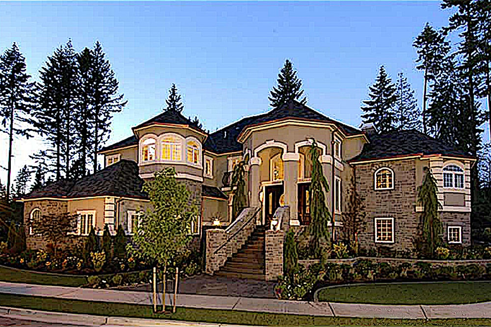 European style home with beige stucco exterior