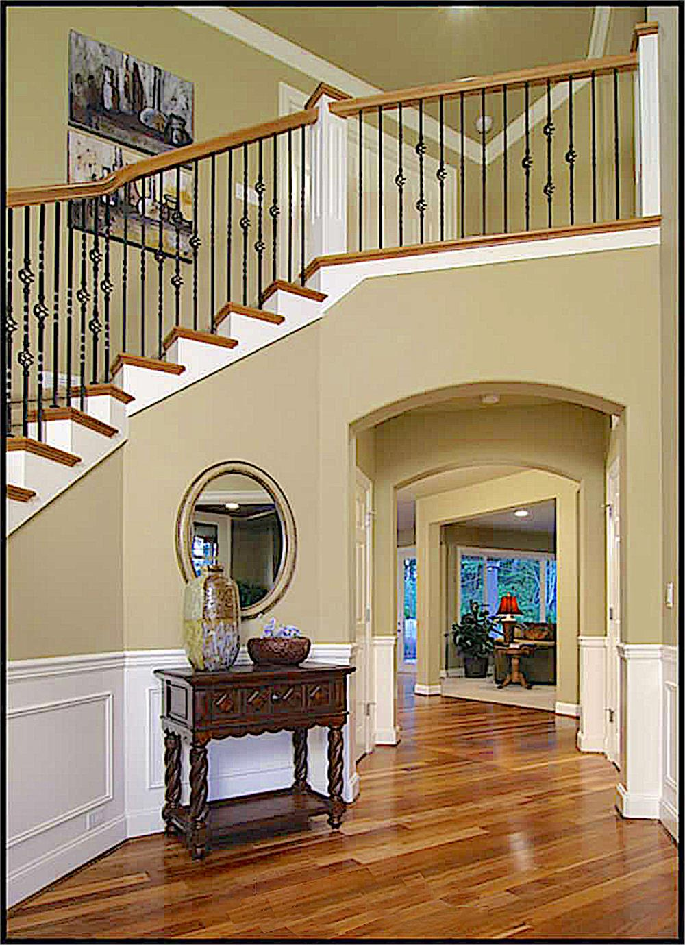 Entry wall with open staircase and exquisite trim detail