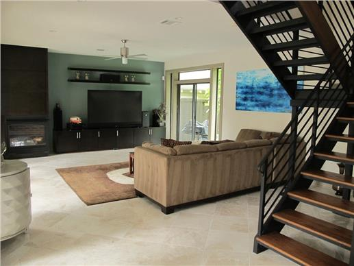 Modern home with open floor plan and plenty of automated technology.