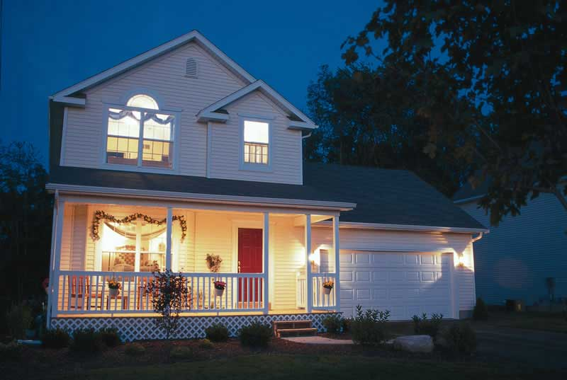 Night view of Country Farmhouse home plan #120-1368
