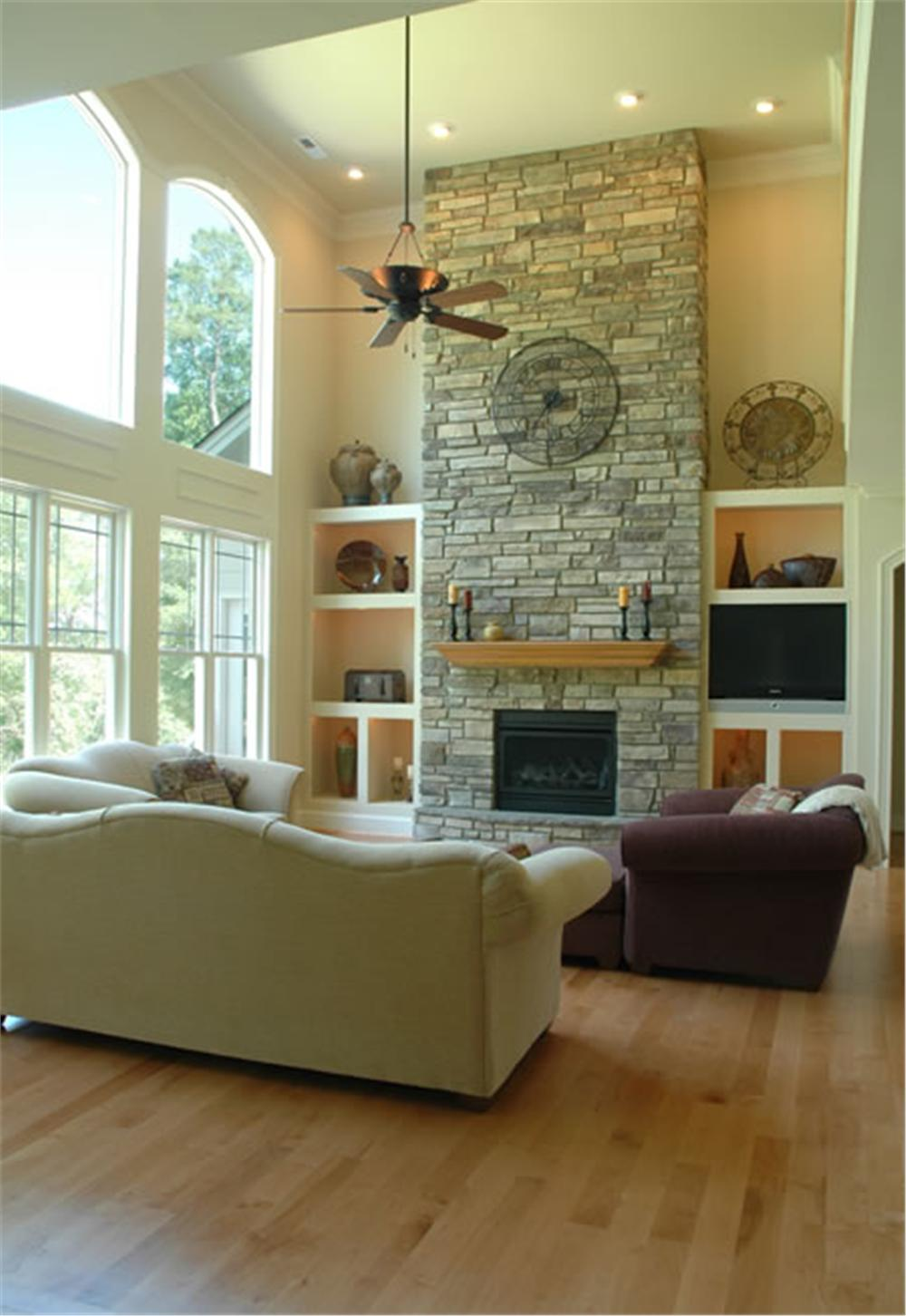 Great Room with neutral paint colors and massive chimney
