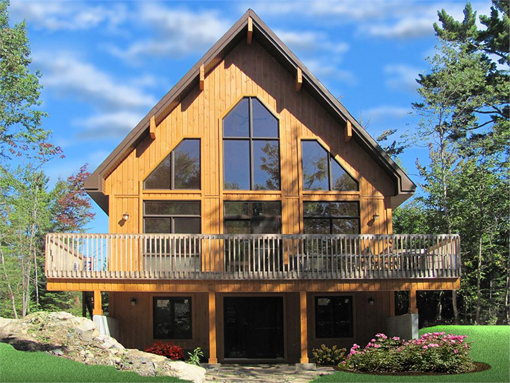 Gorgeous vacation home with board-and-batten siding and steep roof to shed winter snow