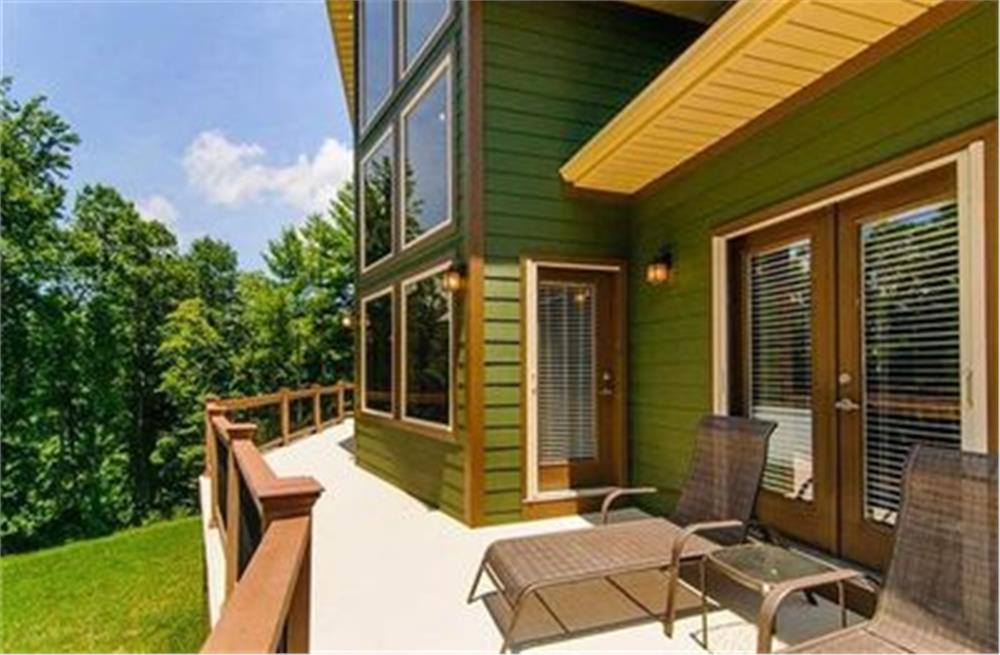 Wood deck off the rear of a house with lounger, perfect for sunbathing