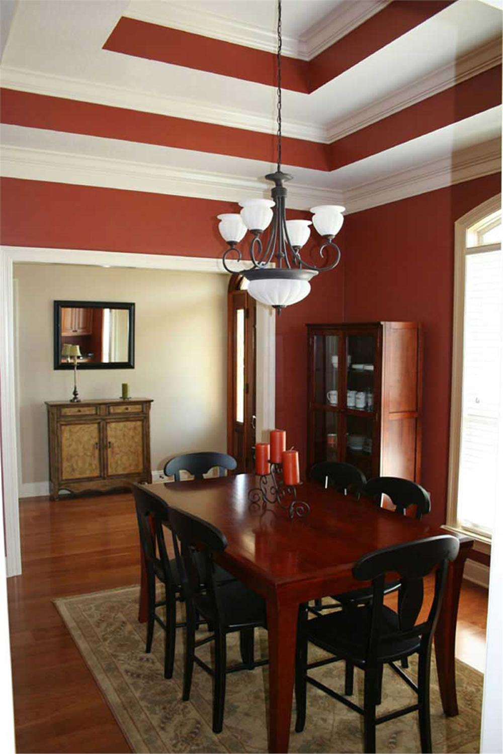 Red dining room with tray ceiling