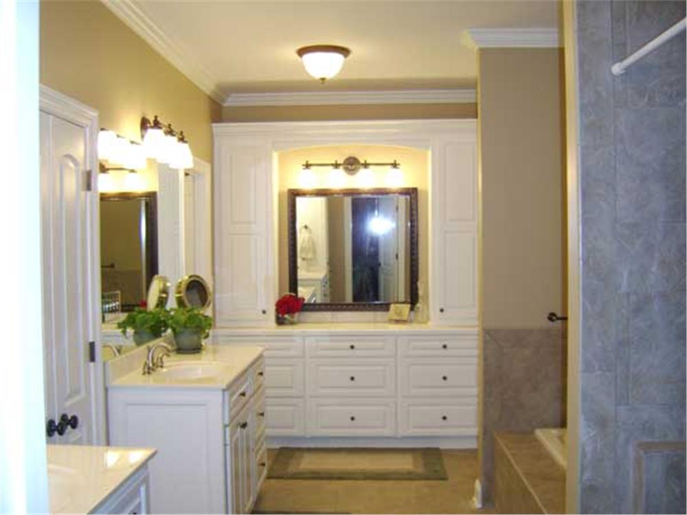 Two vanities separated by a door in master bathroom of House Plan #141-1097