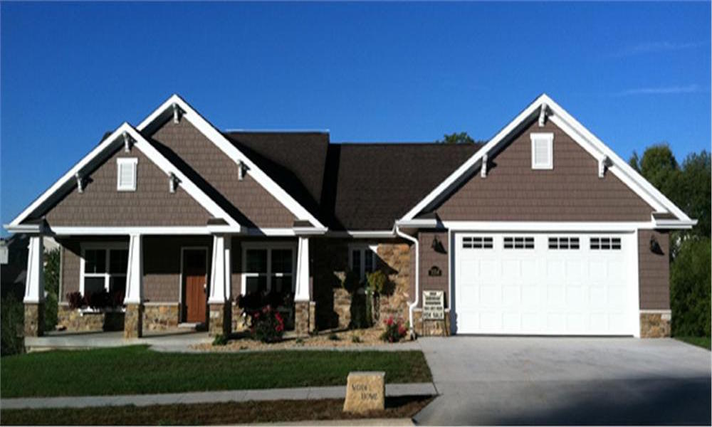 Traditional craftsman style ranch with front facing garage.