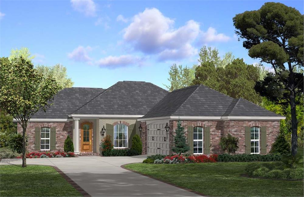 L-shape Acadian style home with brick siding and hip roof
