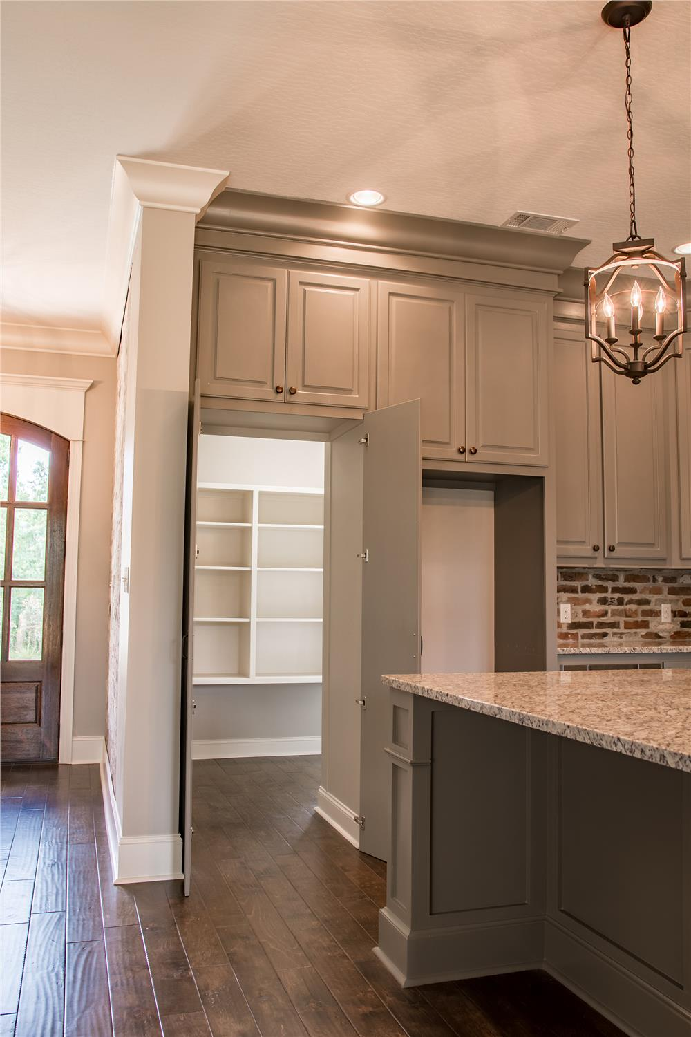 Spacious walk-in kitchen pantry in House Plan #142-1160