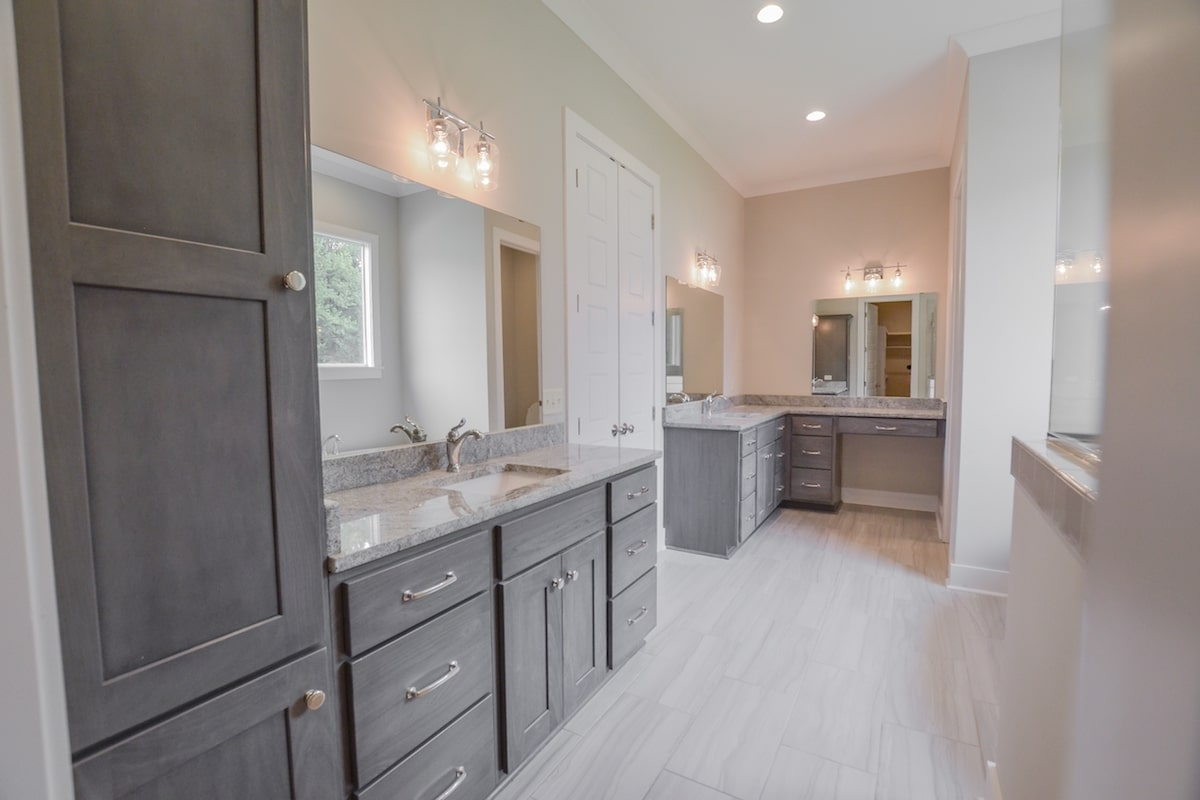 Modern master bathroom with his and her vanities