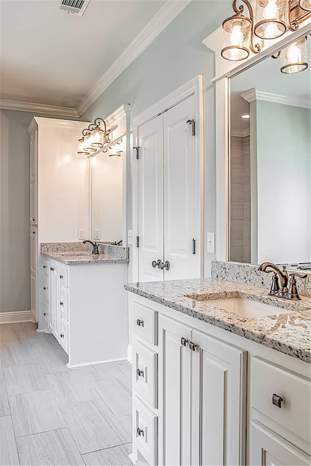 Bathroom with his and her vanities separated by the double door to the master bedroom