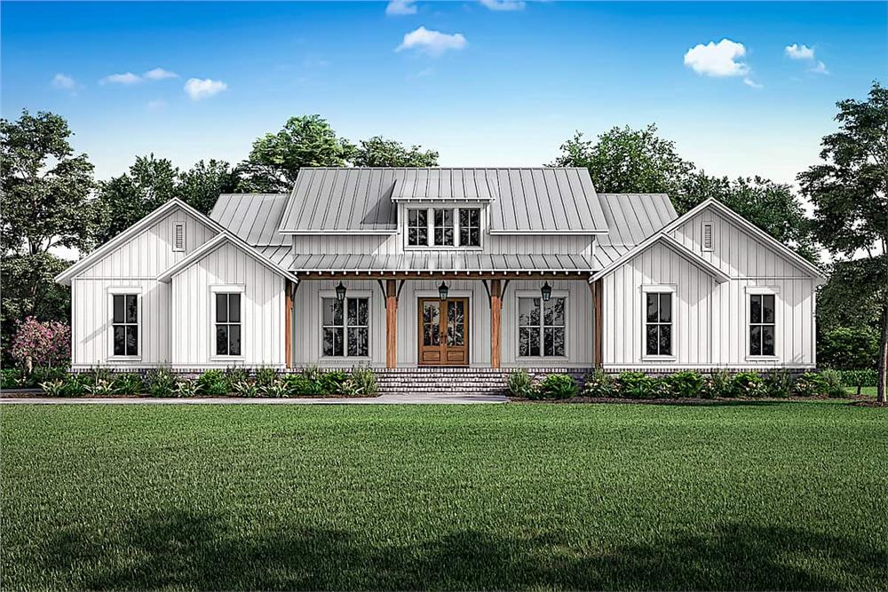 Farmhouse style home with white vertical siding and metal rood