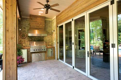 Large glass doors can open to blur the line between indoors and out in house plan #153-1897.