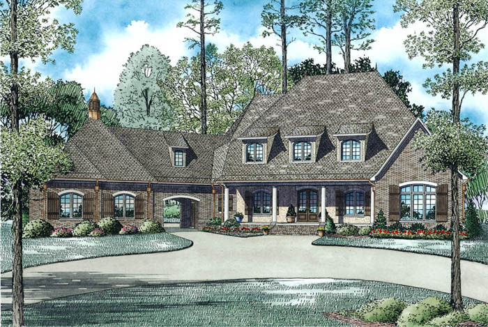 Brick-and-stucco-sided European style home with hip roof and shed dormers