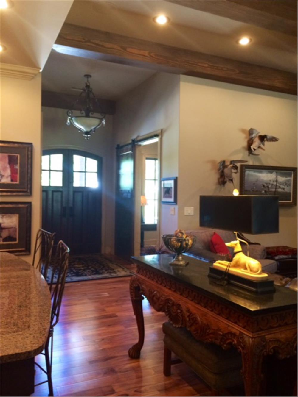 Entry in a home with rustic decor and large ceiling beams