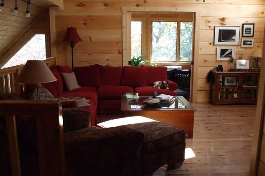 Loft space converted into quiet reading and work room in 1154-sq.-ft. country home.