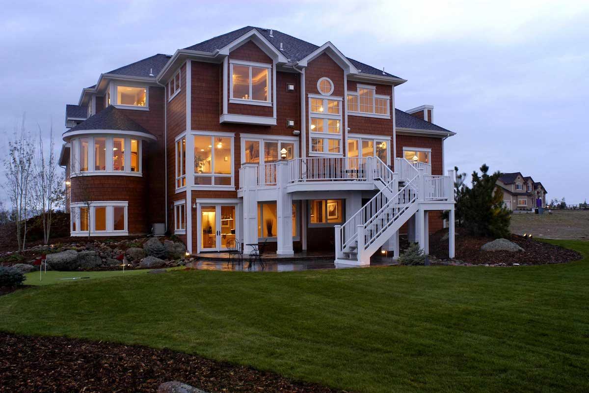 Rear view of Shingle style house plan #161-1038