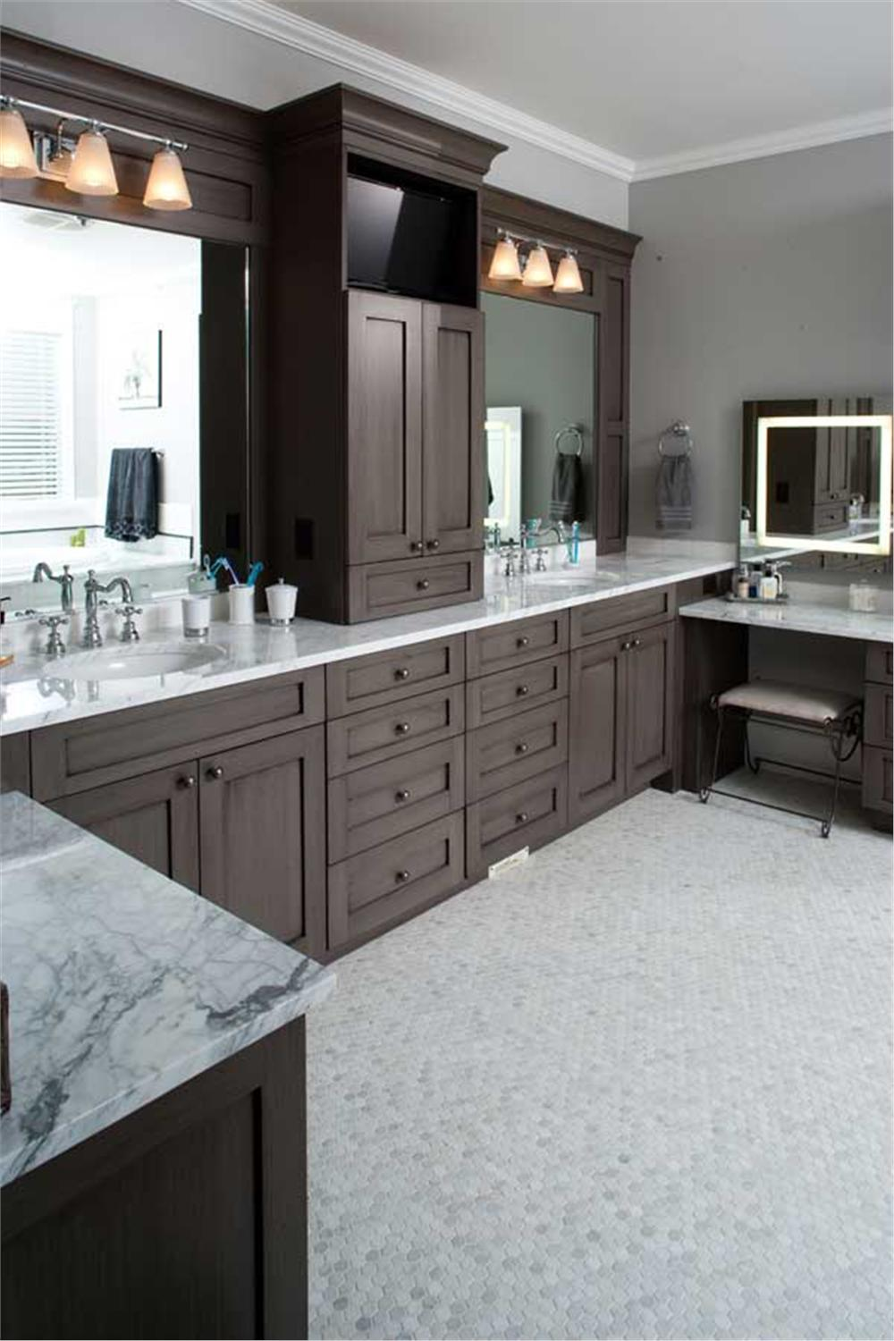 Split vanity in mater bathroom of House Plan #161-1044