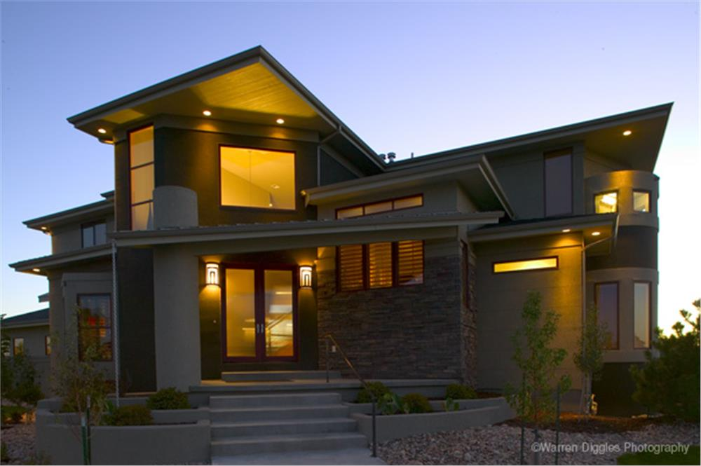 Contemporary home with rooflines that seem to jut out and pierce the sky