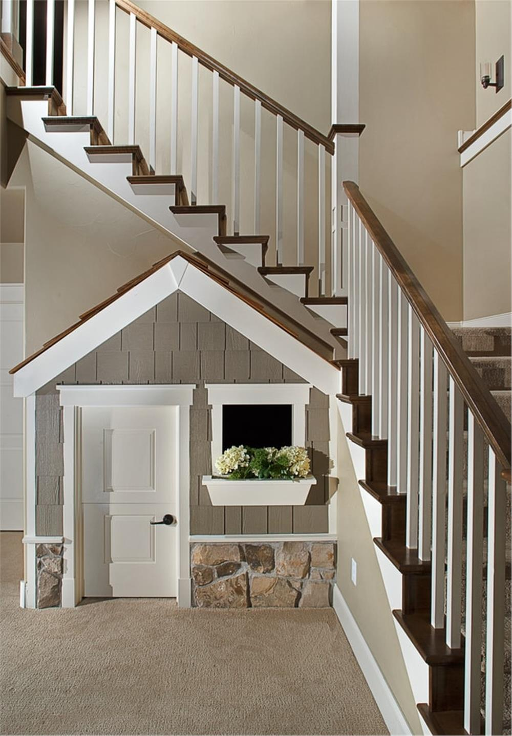 Staircase in a two-story home with creative storage under the landing