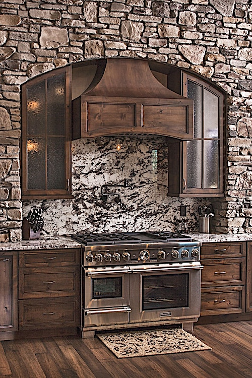 Lots of stone and natural wood spell rustic in this kitchen