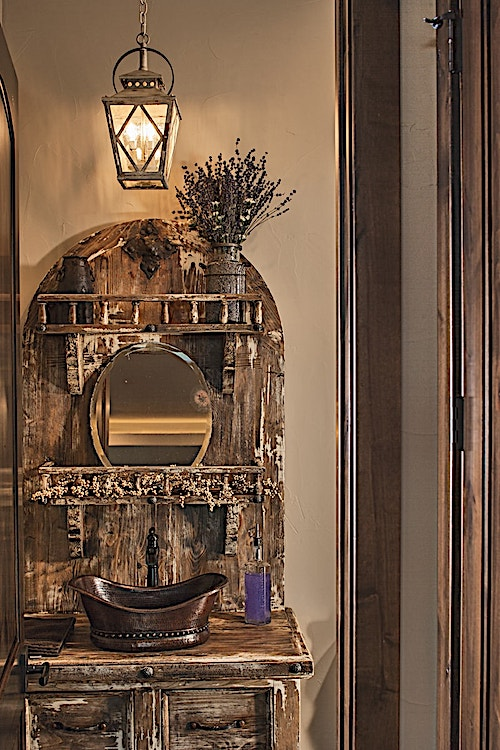 Vanity in a powder room that has rustic style detailing