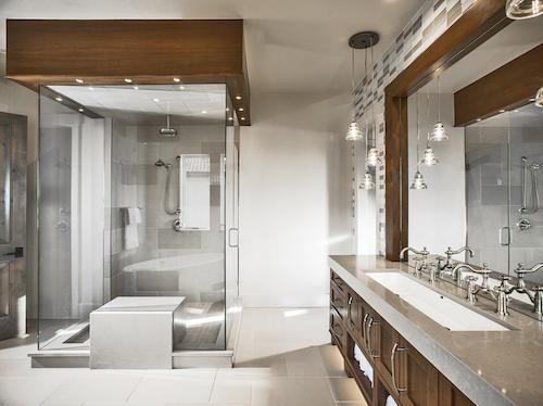 Modern, sleek bathroom with glass-encased shower and tub
