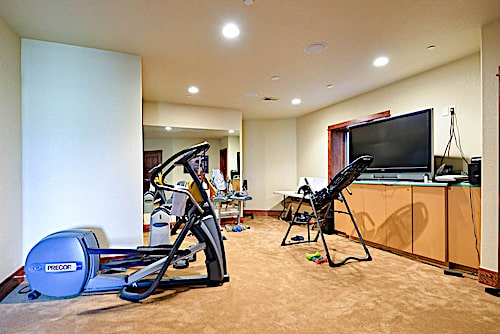 Exercise room in the basement of a charming Ranch style home
