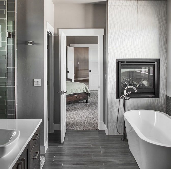 Gray-and-white-patterned tiles in the master bathroom of a 2-story, 3-bedroom Contemporary style home uses large