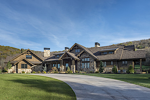 Rustic Ranch style home with lots of wood and stone detailing