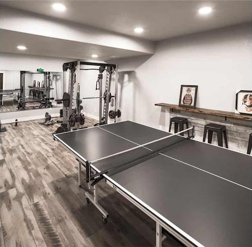Exercise room with gym equipment and game tables