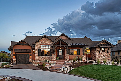 Modest Rustic Ranch style home with stone block siding
