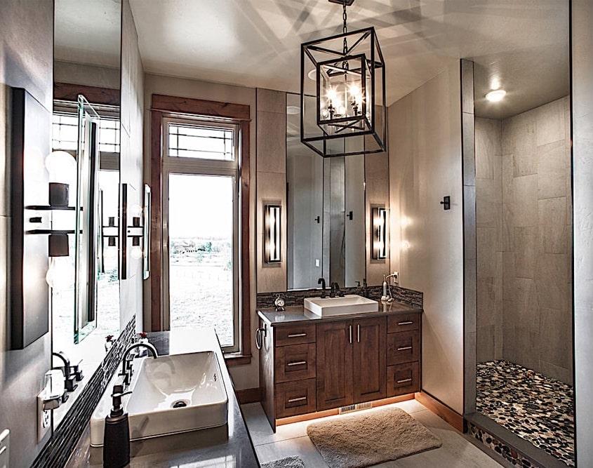 Beautifully modern split vanity master bathroom with great lighting variety