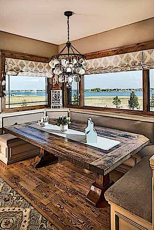 Dining room with dark wood floor in Rustic style home
