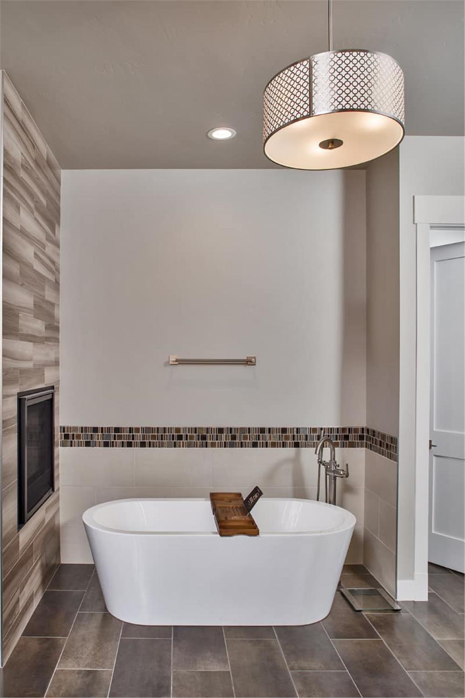 Standalone soaking tub in private corner of larger master bathroom