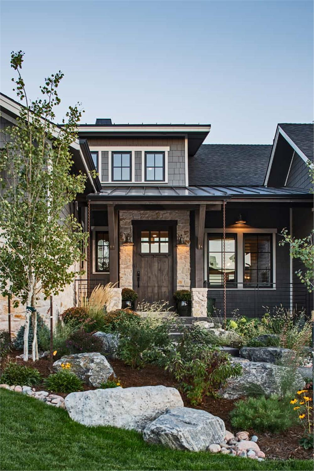 Landscaped entrance at the front door of a Country Ranch style home