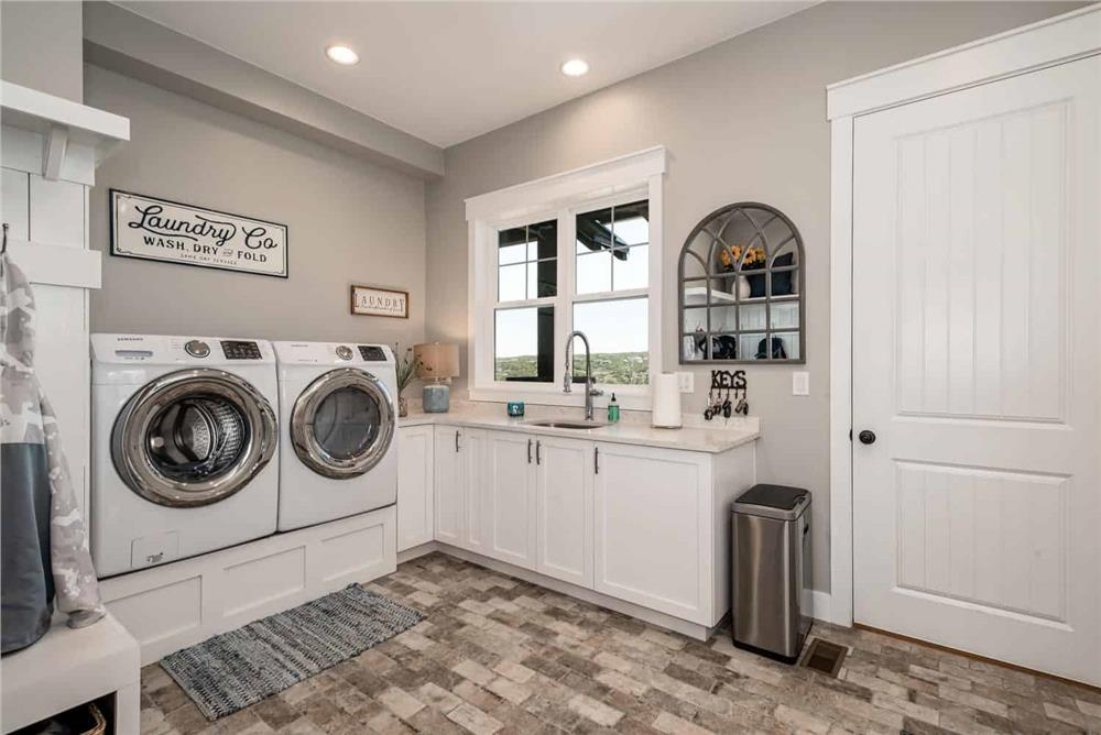 Light-colored laundry room with custom window and door casings