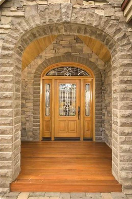 Arched entryway with hand-crafted stone.